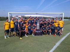 LA Galaxy pose with the Stanley Cup after practice
