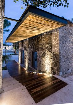 Niop Hacienda by AS Arquitectura - wood inlay...and floating roof with good lighting.