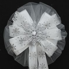 This silver glitter snowflake wedding bow is perfet for the bride whos dreamed of a winter wedding our collection of glitter snowflake bows