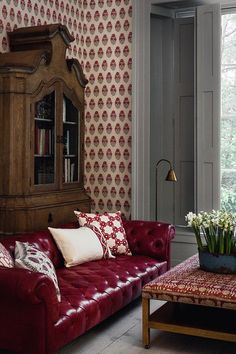 Crimson Leather Sofa | Scarlet Cushions | Pattern Wallpaper - Living Room Ideas (houseandgarden.co.uk)