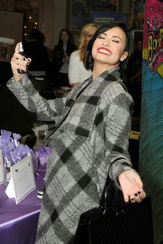 """@justcatchmedemi: Demi Lovato at the #DevonnebyDemi booth at KIIS FM's Jingle Ball 2014 gifting lounge - December 5th."