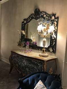It's golden with ornate embellishments, upholstered in a beautiful silk: It's a baroque sofa. Or is it a Rococo style sofa? Both of these furniture styles Mirrors And Marble, Small Dressing Table, Spiegel Design, Rococo Style, Baroque Fashion, Cabinet Styles, Table And Chair Sets, Blue Accents, Cool Chairs