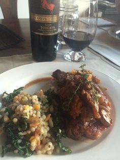 Steak with heirloom tomato, thyme, onion red wine reduction with a side of kale harvest blend & of course vino