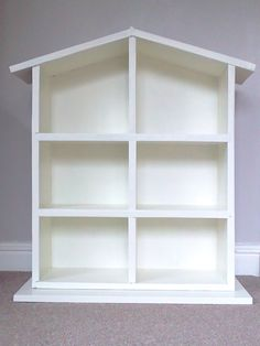 This is a simple dolls house, painted white, which provides the basis for a childs own creative flair for decoration and furnishing to develop.