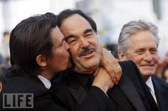 Cannes 2010: C'mere, You!  Josh Brolin kisses his director, Oliver Stone, at the Wall Street: Money Never Sleeps premiere, May 1