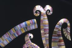Jane Adam - Brooches in carved and dyed anodised aluminium  1996