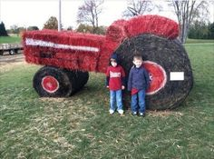 A giant red tractor made out of hay!