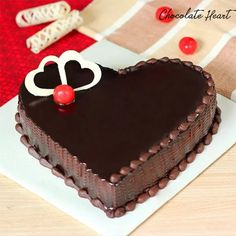 Delicious heart-shaped chocolate cake topped with a chocolate glaze, two heart-shaped white chocolate bars and a cherry on the top.Express your utmost love for the special person in your life in the most romantic way. Chocolate Cream Cake, Chocolate Glaze, Chocolate Bars, White Chocolate, Heart Shaped Cakes, Heart Cakes, Heart Shape Cake Design, Bolo Red Velvet, Buy Cake