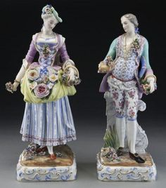 "Pr. Meissen style porcelain figures of a man and woman gazing downward with basket of flowers in hand, each with elaborately decorated costume and raised on square plinths with scroll motif. With crossed sword mark in blue underglaze. Repaired and lacking some elements. Woman: 17.75""H, Circa - Late 19th C."