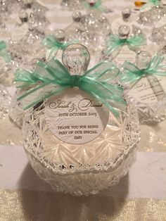 bonbonniere... French pear candle in crystal cut glass jars. Thank you tags created by deciduous press