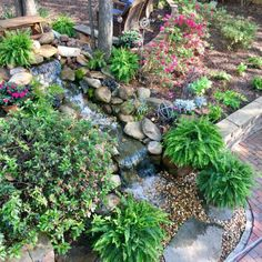 The Husband put in a pondless waterfall as part of our big backyard makeover! Today, I'm giving you a peek at the waterfall and the backyard project! Large Backyard Landscaping, Big Backyard, Ponds Backyard, Landscaping With Rocks, Landscaping Tips, Backyard Waterfalls, Diy Waterfall, Garden Waterfall, Kid Friendly Backyard