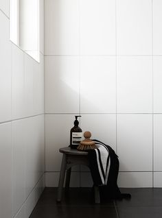 White tile on walls with charcoal tile on floor.  Wood and concrete in a new build - COCO LAPINE DESIGN