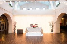 Sweet heart table on dance floor with twinkle lit wall. Burlap, lace and ivory.Upgraded Floral centerpiece and manzanita trees by @petalsandlucy.Photo from Aldea Gallery  collection by StepOnMe Photography