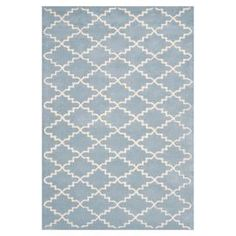 Wool rug with a Moroccan tile motif. Hand-tufted in India.   Product: RugConstruction Material: WoolColor: Blue and ivoryFeatures:  Made in IndiaHand-tufted Note: Please be aware that actual colors may vary from those shown on your screen. Accent rugs may also not show the entire pattern that the corresponding area rugs have.Cleaning and Care: Professional cleaning recommended