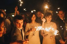 Sparklers wedding photo from a rustic outdoor wedding at Folly Farm - a beautiful countryside reserve close to Bath & Bristol, UK | Photo by Liron Erel Echoes & Wild Hearts