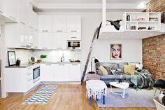 7-estudio-32-m-2-com-parede-de-tijolinho-e-cozinha-americana-branca