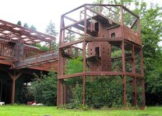 A bunch of different cat condos n outdoor cat enclosures.