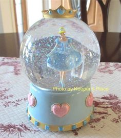 """SOLD:...Adorable Cinderella snow globe that your little princess will just love    Musical plays """"Swan Lake""""    Stands 6.5"""" tall with a base diameter of 4""""    No chips, cracks or repairs"""
