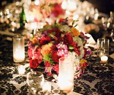 Bright flowers against a damask tablecloth