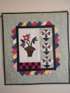 This one of a kind wall hanging was created using some miniature orphan blocks I purchased at my quilt guilds country store. The three tiny