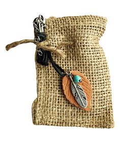 Izzybell Aromatherapy Jewelry Feather Aromatherapy Necklace | zulily  . $12.49 $19.95 Product Description:  A natural clay pendant complements breezy ensembles with earthy allure and provides a place to dab essential oils for soothing aromatherapy benefits.      Cord: 18'' L with 2'' extension     Pendant: 1'' W x 1.5'' L     Clay / cotton / metal     Made in the USA