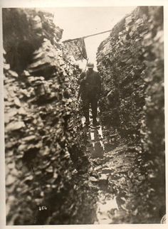 British trench and soldier. The relentless mud and muck in the bottom of the trench cause much grief for the soldiers who were told to keep their boots dry to avoid becoming infected with trench foot.