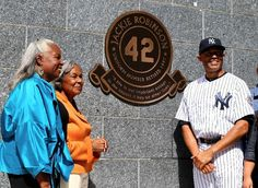 Mariano Rivera #42 of the New York Yankees and the wife and daughter of Jackie Robinson, Rachel Robinson (R) and Sharon Robinson (L) watch as a plaque is unveiled in Monument Park prior to the game against the San Francisco Giants during interleague play on September 22, 2013 at Yankee Stadium in the Bronx borough of New York City. (Photo by Elsa/Getty Images)