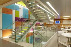 A colorful feature staircase connects the three upper floors of the building, opening up the space.