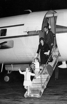 President John F. Kennedy with the First Lady Jacqueline, their daughter…