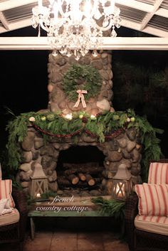 FRENCH COUNTRY COTTAGE: Outdoor Rock Fireplace Dressed for Christmas