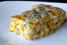 Baked Creamy Corn Casserole Ingredients 1/2 cup milk, divided 1/2 cup heavy cream 2 Tbl butter, unsalted 1 1/2 Tbl sugar 2 Tbl flour 1 tsp salt 4-5 cups corn kernels, fresh or frozen (thawed) – well drained 2 large eggs 1/4-1/2 cup shredded Asiago (optional) Chives for garnish
