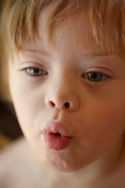 language and oral movements are linked in both typical and atypical development