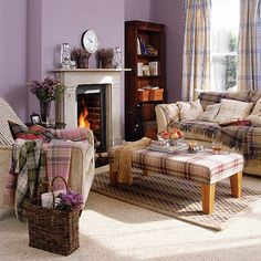 This colour is often branded 'bedroomy'. This photograph demonstrates how warm and soothing it can be in a sitting room. The wool tartan throws are gorgeous! New Home Interior Design: Traditional Living Room Lilac Living Rooms, Purple Rooms, Living Room Grey, Home And Living, Living Room Furniture, Living Room Decor, Cozy Living, Living Area, Purple Walls