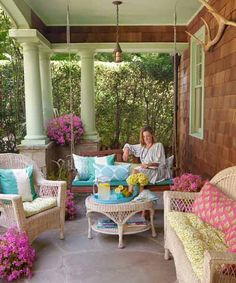 What could be better than sitting on a comfy, cushioned porch swing with a good book on a warm summer day? | Photo: Wendell T. Webber