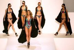 Jennifer Hawkins, wearing  swimmers from her own label Cozi, leads the way  at the Myer show yesterday.  Black capes by Empireroom
