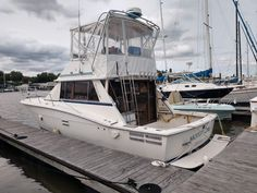 """1986 Trojan 36' """"Motley Crew"""" - Recent Price Reduction! This Trojan F-36 is ready to cruise to your favorite destination or take the whole crew out for some serious fishing. With a generator and AC/Heat, you can pilot her from inside and stay comfortable year round while exploring the Bay. Her twin Crusaders are fresh water cooled and are in good running order. Inside you will find a spacious salon, well appointed galley, and a large head with separate shower stall. Price $20,000"""