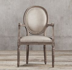 RH's Vintage French Round Fabric Armchair:Our reproductions of vintage French dining chairs display the elegant restraint emblematic of neoclassicism. Defined by linear form, tapering fluted columnar legs and scooped arms, the chairs have been updated in hand-carved oak with a soft, weathered finish.