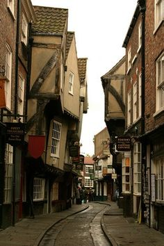 """""""I've always loved the sound of the street named The Shambles, York's finest medieval street. It so aptly depicts the topsy-turvy nature of the top-heavy houses that lean precariously towards one another on either side of the narrow lane. Each house seems close enough that you could quite easily shake hands with neighbours on the opposite side of the street by merely opening a top floor window."""" Slow Travel North York Moors; www.bradtguides.com"""