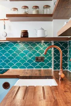Our Alto Brushed Copper Tap sparkles in this gorgeous coastal themed kitchen. A perfect match with wood and sea green accents! Kitchen by the wonderful FincH