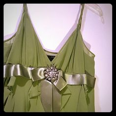 BCBG Silk Spaghetti Strap Dress Rich green color, 100% silk, twisted straps,  Satin ribbon under bust adorned with rhinestone broach.  Worn once Ask any questions. Offers welcome BCBGMaxAzria Dresses