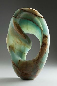 Tintamarre by Katusha Bull -- Carved Patagonian Onyx.