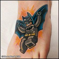 Batman foot tattoo by Chris Hill.
