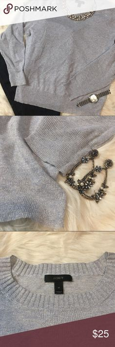 J. Crew Grey Silver Metallic Fine Knit Sweater Gorgeous J. Crew Silver Grey Fine Knit Sweater in excellent condition. Shimmery metallic all-over accents give this thin fine knit sweater a luxurious feel. Smoke & Pet Free Home. Bundle & Save! J. Crew Sweaters Crew & Scoop Necks