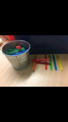 Placing the right amount of pegs onto the sticks depending on what number is on them. Opening the pegs help to strengthen the fine motor skills. This activity also supports maths 1-1 correspondence.