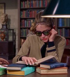 """#Bookbabe #HollyGolightly (née #AudreyHepburn), studying in The #NewYorkPublicLibrary c.1961, while…"""