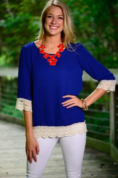 This blue blouse is charming! We love the crochet trim on the hem! This trendy blouse is perfect for those warm days with the light material!