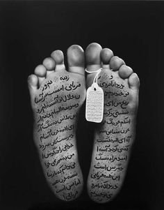 Shirin Neshat iraq artist depicting arabic writing with symbols of violence to speak out against the wrongs in her homeland.