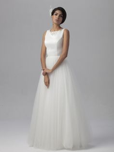 Satin and tulle ballerina inspired wedding gown with embellishments at the top for less than $800