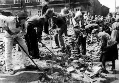 July 1943: Soviet marines give a hand to the people of Leningrad during clean-up work to remove debris from areas of the city bombed by the Germans.
