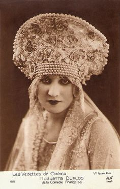 "Huguette Duflos a famous french actress  Perhaps a card referring to Duflos  role as princess Olga in ""La princesse aux clowns"" (1924)."